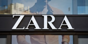 A logo sits on display above the entrance to a Zara retail store, operated by Inditex SA, in Barcelona, Spain, on Tuesday, April 16, 2013. Mango has ditched the glitz in favor of more casual attire like that from Spanish rival Inditex SA, the world's biggest seller of apparel and owner of the Zara brand. Photographer: David Ramos/Bloomberg via Getty Images